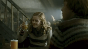 Film still: Hermione and Ron enjoy butterbeer.